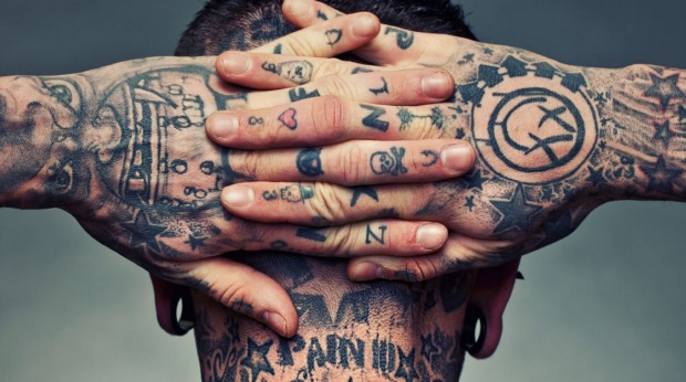 tattoos on hands and back of neck